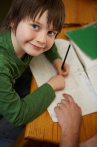 How to Homeschool My Child boy working at desk