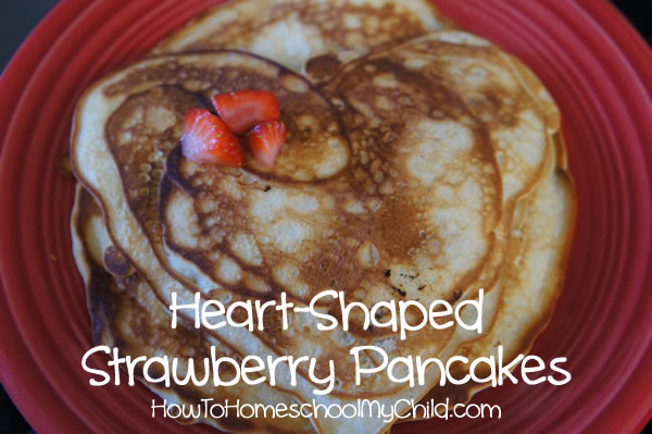 valentines day recipes -heart-shaped strawberry pancakes, with coconut, pecans & white chocolate chips from HowToHomeschoolMyChild.com