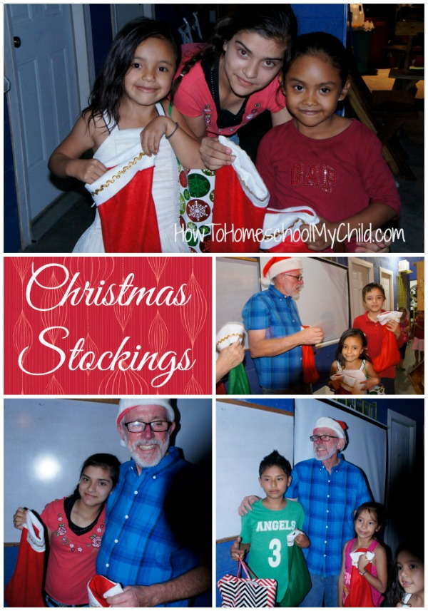 Passing out stockings of fruit at Christmas party in El Salvador - family mission trip